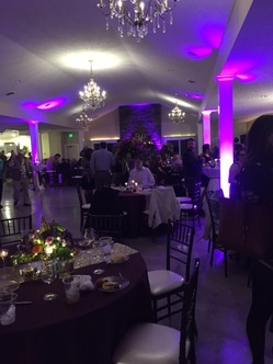 Holly Field Manor's reception hall lit up with dancing and a DJ.